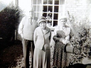 Bill Minchin, Alice Lambert, May Minchin in front garden, 12 Rissington Road, Bourton, early 1960s. Bill wearing tie, May in best frock. Why is Alice visiting from Lincolnshire? Looks like special occasion.
