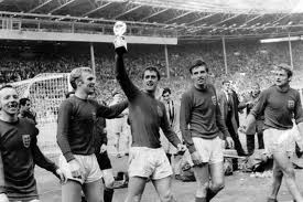 Martin Peters, right, as England win the 1966 World Cup. John had played alongside Peters.