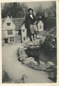 Peggy poses at the Model Village, Bourton, about 1949.