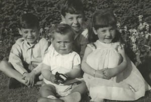 Paul, Andrew and Jayne with Nicky holding a toy gun at the front.